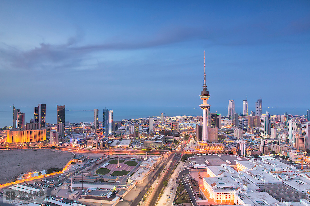 "Kuwait, officially the State of Kuwait i/kuːˈweɪt/ (Arabic: دولة الكويت‎ Dawlat al-Kuwayt ), is a sovereign Arab state situated in the north-east of the Arabian Peninsula in Western Asia. It lies on the north-western shore of the Persian Gulf and is bordered by Saudi Arabia to the south (at Khafji) and Iraq to the north (at Basra). The name Kuwait is derived from the Arabic أكوات ākwāt, the plural of كوت kūt, meaning ""fortress built near water"".[6] The country covers an area of 17,820 square kilometers (6,880 square miles) and has a population of about 3.5 million.[3]"