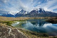 A beautiful mid day sky highlights the peaks of Torres del Paine. Patagonia, Chili