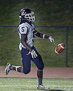 Central Bucks East's Myles King (5) throws down the football after he scores a touchdown against Council Rock North in the first quarter at Council Rock North Saturday October 15, 2016 in Newtown, Pennsylvania.  (Photo by William Thomas Cain)