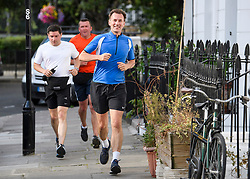 © Licensed to London News Pictures. 10/07/2018. London, UK. Newly appointed Foreign Secretary JEREMY HUNT is seen being followed by police security detail while jogging near his London home. Cabinet resignations by Former Foreign Secretary Boris Johnson and former Brexit secretary David Davis have put pressure on Prime Minister Theresa May over her handling of the Brexit negotiations, with suggestions of a leadership challenge. Photo credit: Ben Cawthra/LNP