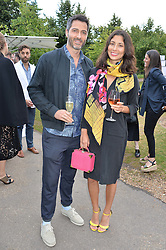 JASMINE HEMSLEY and NICK HOOPER at a party hosted by fashion store COS to celebrate The Serpentine Park Nights 2016 held at The Serpentine Gallery, Kensington Gardens, London on 12th July 2016.