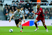Ayoze Perez (#17) of Newcastle United on the ball during the Premier League match between Newcastle United and Liverpool at St. James's Park, Newcastle, England on 4 May 2019.