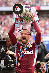 May 27, 2019 - London, England, United Kingdom - Conor Hourihane (14) of Aston Villa holds the trophy during the Sky Bet Championship match between Aston Villa and Derby County at Wembley Stadium, London on Monday 27th May 2019. (Credit: Jon Hobley | MI News) (Credit Image: © Mi News/NurPhoto via ZUMA Press)