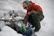 Alex Yoder hydrates with natural spring water near Moiwa resort, Niseko, Hokkaido, Japan.