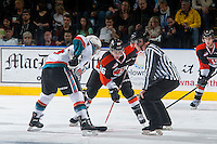 KELOWNA, CANADA - JANUARY 10: Cole Sanford #26 of Medicine Hat Tigers faces off against the Kelowna Rockets on January 10, 2015 at Prospera Place in Kelowna, British Columbia, Canada.  (Photo by Marissa Baecker/Shoot the Breeze)  *** Local Caption *** Cole Sanford;