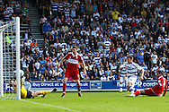 Loftus Road, London - Saturday 11th September 2010: Jamie Mackie (12) of QPR scores their third goal past Jason Steele (30) of Middlesborough during the Npower Championship match between Queens Park Rangers and Middlesborough. (Photo by Andrew Tobin/Focus Images)
