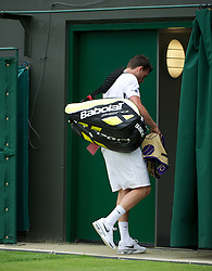 LONDON, ENGLAND - Monday, June 25, 2012: Heading for an early exit? Josh Goodall (GBR) walks off dejected after losing during the Gentleman's Singles 1st Round on the opening day of the Wimbledon Lawn Tennis Championships at the All England Lawn Tennis and Croquet Club. (Pic by David Rawcliffe/Propaganda)