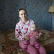 Tania, with her daughter who suffer from cancer. Tania is living temporaly at Dacha House in the outskirt of Kiev, Ukraine.