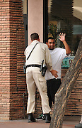 Arizona Department of Public Safety officers question a man regarding an incident in downtown Tucson, Arizona, USA.