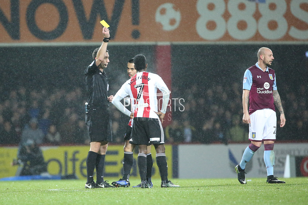 Brentford defender Nico Yennaris (8), yellow card during the EFL Sky Bet Championship match between Brentford and Aston Villa at Griffin Park, London, England on 31 January 2017. Photo by Matthew Redman.