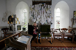 UK ENGLAND THAME 27AUG14 - Dwina Gibb, widow of Bee Gee Robin Gibb poses for a photo at the chapel of her home in Thame, Oxfordshire.<br /> <br /> Behind her are condolences and cards sent from all over the world following Robin Gibb's death in May 2012.<br /> <br /> <br /> <br /> jre/Photo by Jiri Rezac<br /> <br /> © Jiri Rezac 2014