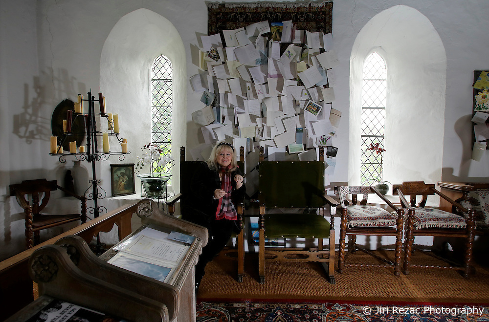 UK ENGLAND THAME 27AUG14 - Dwina Gibb, widow of Bee Gee Robin Gibb poses for a photo at the chapel of her home in Thame, Oxfordshire.<br /> <br /> Behind her are condolences and cards sent from all over the world following Robin Gibb's death in May 2012.<br /> <br /> <br /> <br /> jre/Photo by Jiri Rezac<br /> <br /> &Acirc;&copy; Jiri Rezac 2014