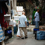 Man at a street market in Hong Kong