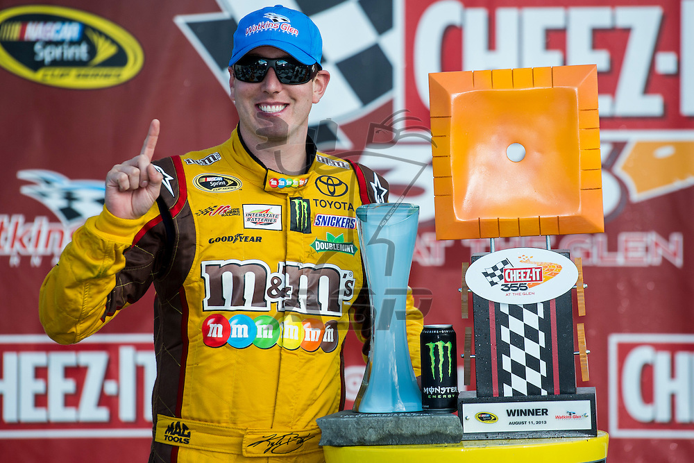 Watkins Glen, NY - AUG 11, 2013: Kyle Busch (18) wins the Cheez-It 355 at The Glen at the Watkins Glen International in Watkins Glen, NY.
