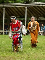 During the Inter Tribal dance Jon Bautel of Grafton dances in an Abenaki - Anishinabi regalia gifted to him through a friend from an elder and Sharon Smart of Laconia wears an Algonquin regalia she made to replicate her animal spirt - fawn during LIHA's annual Labor Day Pow Wow in Sanbornton.     (Karen Bobotas/for the Laconia Daily Sun)
