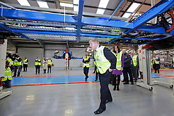 © Licensed to London News Pictures. 29/02/2016. Antrim, Northern Ireland, Mayor of London, Boris Johnson MP, walks  under a chassis of a bus during a tour of Wrightbus plant in Antrim,  Northern Ireland. Boris was visiting businesses that are supported by investment from Transport for London. Photo credit : Paul McErlane/LNP