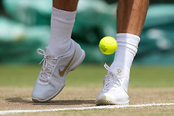 LONDON, ENGLAND - Wednesday, June 30, 2010: The Nike tennis shoes of Roger Federer (SUI) during the Gentlemen's Singles Quarter-Final on day nine of the Wimbledon Lawn Tennis Championships at the All England Lawn Tennis and Croquet Club. (Pic by David Rawcliffe/Propaganda)