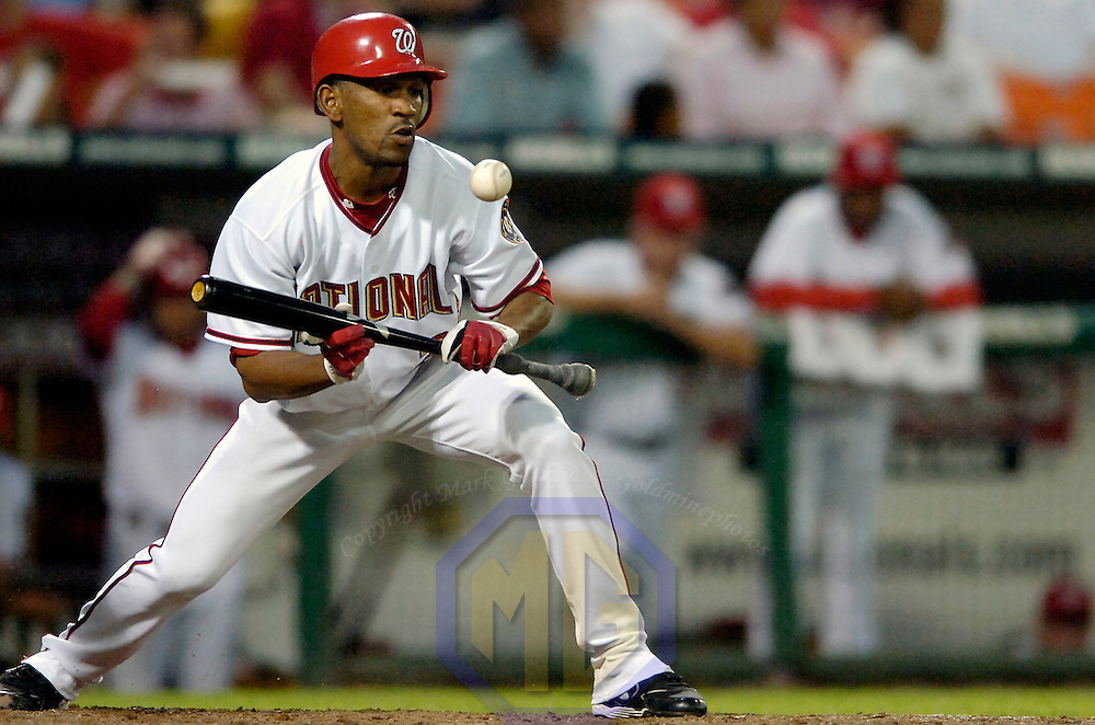 09 August 2006:  The Washington Nationals Ramon Ortiz (26) is called out when the his attempted bunt hits him in the fourth inning against the Florida Marlins Dontrelle Willis.  The Nationals defeated the Marlins 5-2 at RFK Stadium in Washington, D.C.