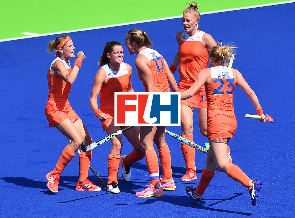 Netherlands' Maartje Paumen (C) celebrates a goal with teammates during the women's semifinal field hockey Netherlands vs Germany match of the Rio 2016 Olympics Games at the Olympic Hockey Centre in Rio de Janeiro on August 17, 2016. / AFP / MANAN VATSYAYANA        (Photo credit should read MANAN VATSYAYANA/AFP/Getty Images)