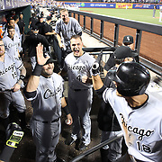 NEW YORK, NEW YORK - May 31:  Tyler Saladino #18 of the Chicago White Sox is congratulated by team mates as he returns to the dugout after hitting a two run homer in the eighth inning during the Chicago White Sox  Vs New York Mets regular season MLB game at Citi Field on May 31, 2016 in New York City. (Photo by Tim Clayton/Corbis via Getty Images)