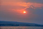 South Saskatchewan River and rolling hills of mixed grass prairie with storm clouds at sunrise<br />Saskatchewan Landing Provincial Park<br />Saskatchewan<br />Canada