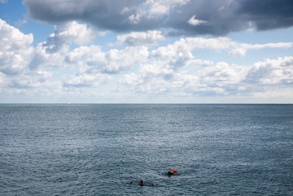 Two sea swimmers return to Folkestone harbour after a training session out in the English Channel, Folkestone, Kent, England, United Kingdom. (photo by Andrew Aitchison / In pictures via Getty Images)