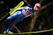 Martin Koch of Austria soars through the air during the FIS World Cup Ski Jumping in Sapporo, northern Japan in February, 2008.