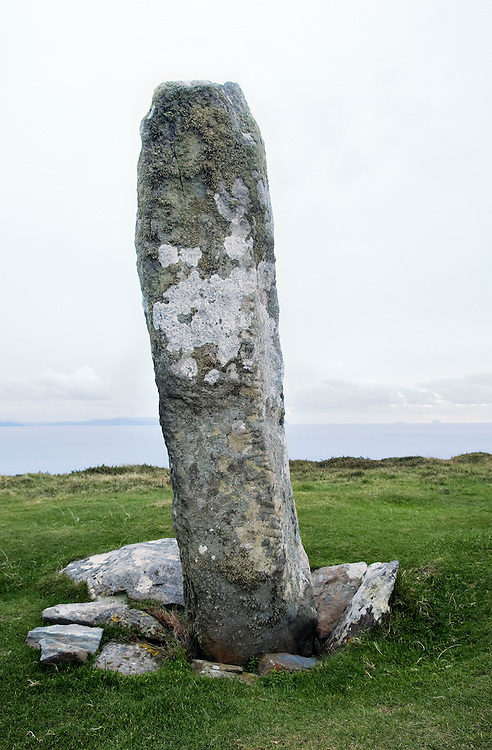 Ancient standing stone on Dunmore Head above Blasket Sound bears ogham inscriptions cut into the corners. County Kerry, Ireland