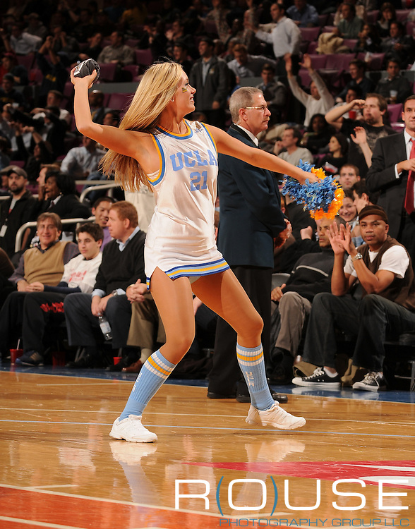 UCLA Cheerleader throws t-shirts into the crown as Michigan beat #4 UCLA 55-52 on Thursday November 20, 2008 to advance to the Championship of the 2K Sports Classic at Madison Square Garden in New York.