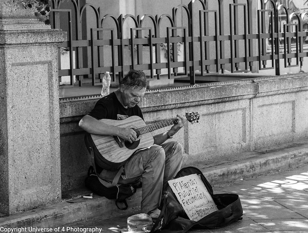 Random street artist in Denver. Using Latin and music to express his opinion.