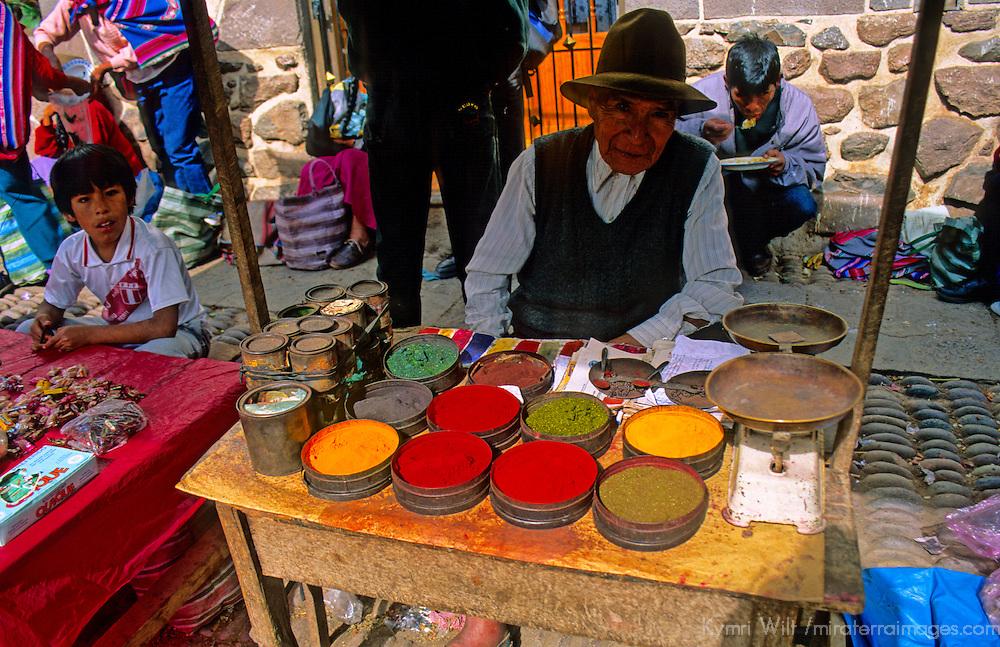 South America, Peru, Pisac. Pigment vendor in market