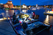 Racers do final preparation for the start of the race, at about 4am under the moonlight. <br />