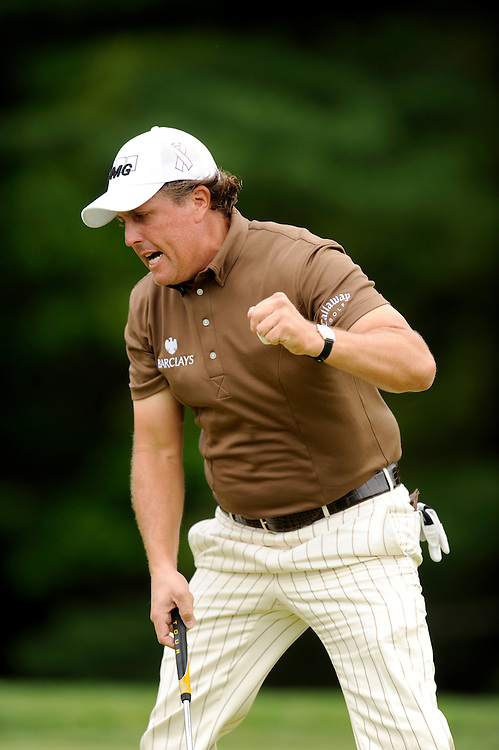 FARMINGDALE, NY - JUNE 22: Phil Mickelson reacts after his eagle on the 13th hole during the continuation of the final round of the 109th U.S. Open on the Black Course at Bethpage State Park on June 22, 2009 in Farmingdale, New York.(Photo by Rob Tringali) *** Local Caption *** Phil Mickelson