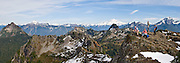 From atop Mount Dickerman, hikers view many Central Cascades peaks including Mount Pugh, Glacier Peak and Sloan Peak in Mount  Baker-Snoqualmie National Forest (Trail #710), accessible from the Mountain Loop Highway east of Verlot, Washington, USA. Panorama stitched from 3 images.