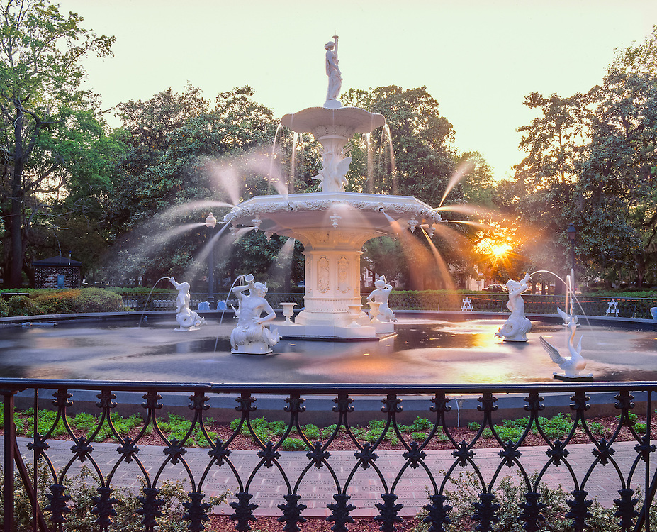 Forsyth park fountain, with jets of water spraying, and sunrays, put in place in July 1858, Forsyth Park, Savannah, GA