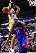 March 30, 2011; Indianapolis, IN, USA; Detroit Pistons power forward Charlie Villanueva (31) breaks up the layup attempt by Indiana Pacers center Jeff Foster (10) at Conseco Fieldhouse. Mandatory credit: Michael Hickey-US PRESSWIRE