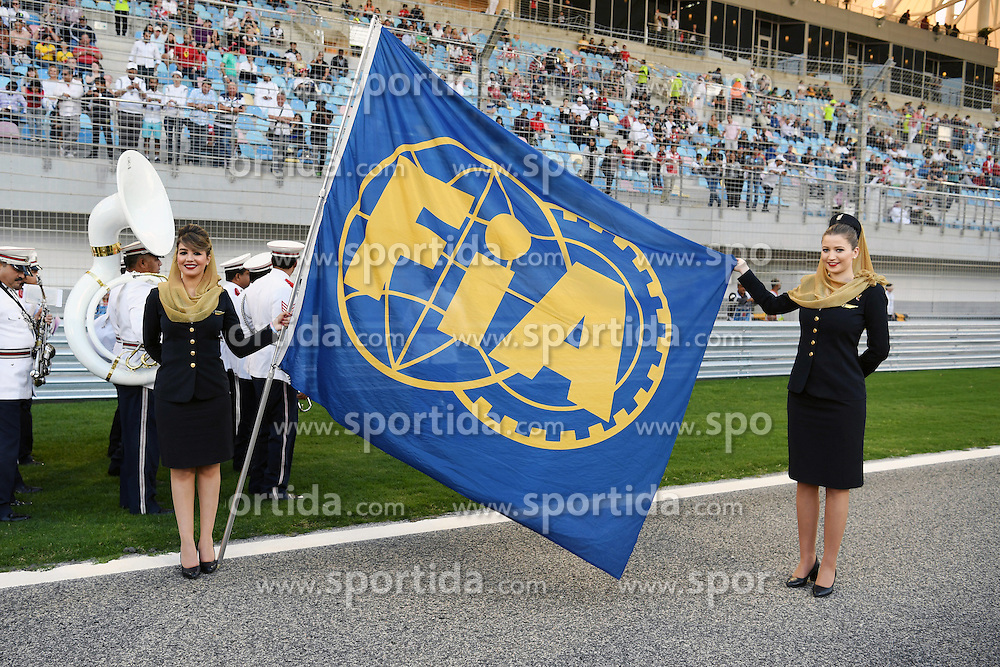 03.04.2016, International Circuit, Sakhir, BHR, FIA, Formel 1, Grand Prix von Bahrain, Rennen, im Bild Grid girls and FIA flag on the grid // during Race for the FIA Formula One Grand Prix of Bahrain at the International Circuit in Sakhir, Bahrain on 2016/04/03. EXPA Pictures &copy; 2016, PhotoCredit: EXPA/ Sutton Images<br /> <br /> *****ATTENTION - for AUT, SLO, CRO, SRB, BIH, MAZ only*****