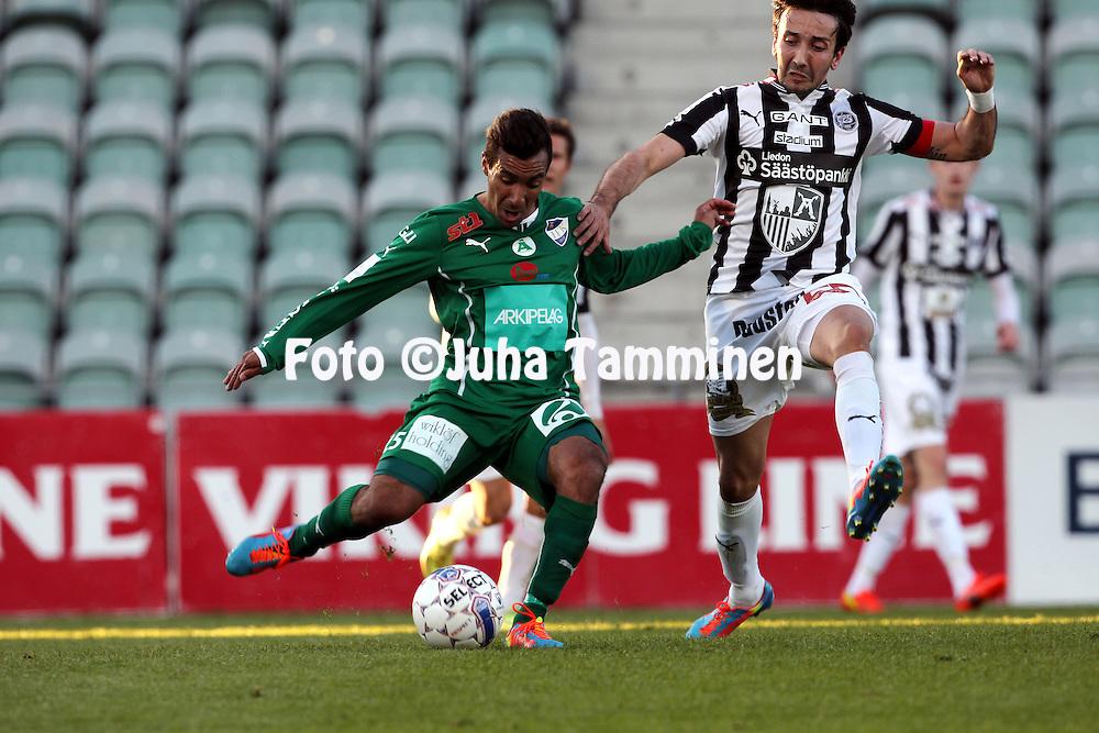 23.4.2014, Veritas Stadion, Turku.<br /> Veikkausliiga 2014.<br /> Turun Palloseura - IFK Mariehamn.<br /> Diego Assis (IFK Mhamn) v Sami R&auml;hm&ouml;nen (TPS).