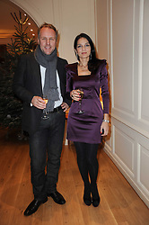 The Ruinart Champagne Christmas drinks party held at Berluti, Conduit Street, London on 9th December 2009.<br /> Picture shows:- SIMON & YASMIN MILLS *** Local Caption *** Image free to use for private use.  If in doubt contact us - info@donfeatures.com