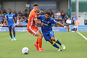 AFC Wimbledon striker Andy Barcham (17) battles for possession with Shrewsbury Town defender James Bolton (13) during the EFL Sky Bet League 1 match between AFC Wimbledon and Shrewsbury Town at the Cherry Red Records Stadium, Kingston, England on 12 August 2017. Photo by Matthew Redman.