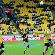 Damian McKenzie kicks during the super rugby union game between Hurricanes and Chiefs, played at Westpac Stadium, Wellington, New Zealand on 13 April 2018. Hurricanes won 25-13.