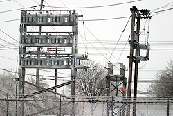 01 December 2006: Ice and snow cover the electrical units in this power sub-station.  A sharp winter storm swept into Central Illinois and the Bloomington-Normal area causing power outages, road closures, white out conditions, tree damage, and virtually every large business and schools to close.<br />