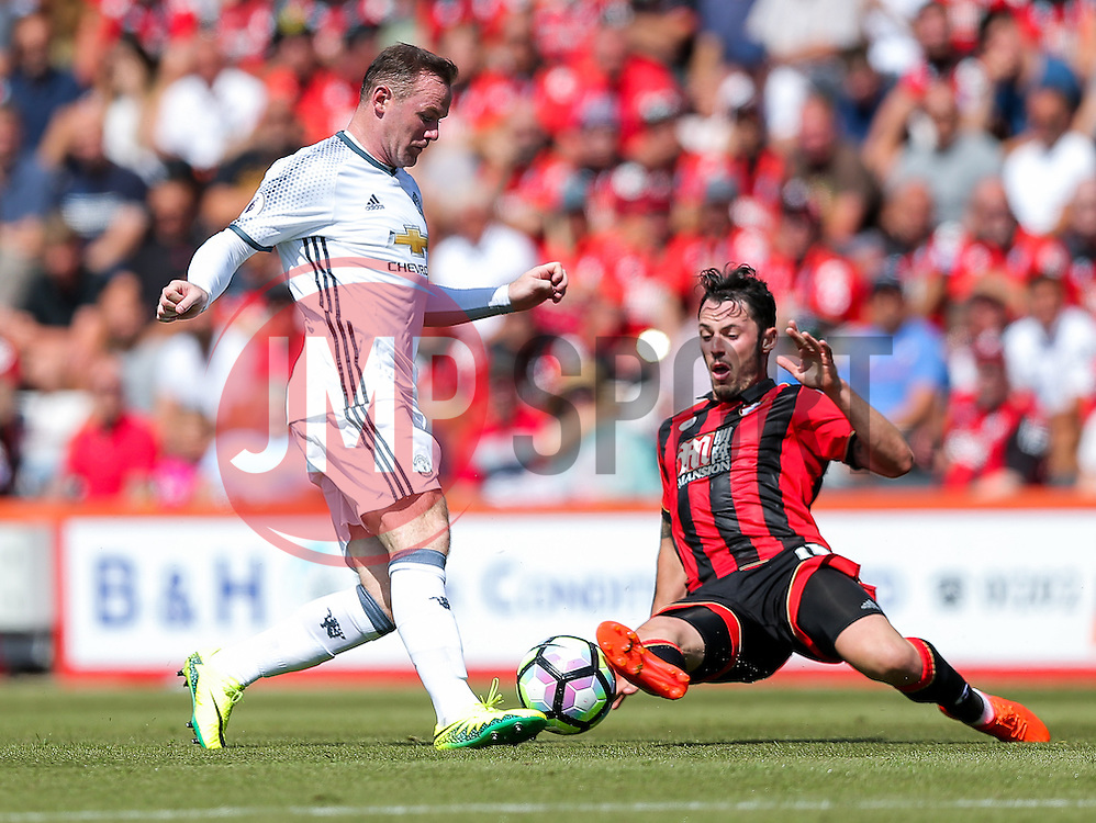 Wayne Rooney of Manchester United is challenged by Charlie Daniels of Bournemouth - Rogan Thomson/JMP - 14/08/2016 - FOOTBALL - Vitality Stadium - Bournemouth, England - Bournemouth v Manchester United - Premier League Opening Weekend.