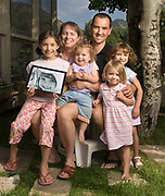 NEWS&amp;GUIDE PHOTO / PRICE CHAMBERS<br /> Ginny and Ken Mahood have four children. From left, Emily, 8, Gabriella, 1, Maria, 3, and Julia, 5. The couple lost their fifth child, Emily's twin sister Clare, to an inoperable brain tumor in 2005. The doctors said she had a 10 percent chance of surviving. &quot;You have to cling to that she is part of that 10 percent,&quot; Ken Mahood said.
