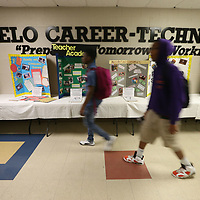 Tupelo High School students walk past a variety of booths showing career paths for students after high school.