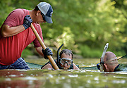 Biologists, students, volunteers, and staff members of the N.C Division of Parks and Recreation set out to catch and collect data on the elusive and largest salamander in North America called the Hellbender.