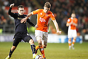 Barnsley's Josh Scowen (6) gets the tackle on Blackpool's Jim McAlister (4) during the The FA Cup 3rd round match between Blackpool and Barnsley at Bloomfield Road, Blackpool, England on 7 January 2017. Photo by Craig Galloway.