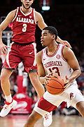 FAYETTEVILLE, AR - MARCH 9:  Mason Jones #13 of the Arkansas Razorbacks gets the defenders in the air during a game against the Alabama Crimson Tide at Bud Walton Arena on March 9, 2019 in Fayetteville, Arkansas.  The Razorbacks defeated the Crimson Tide 82-70.  (Photo by Wesley Hitt/Getty Images) *** Local Caption *** Mason Jones