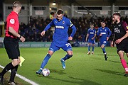 AFC Wimbledon striker Joe Pigott (39) dribbling and stopping the ball from going out during the EFL Sky Bet League 1 match between AFC Wimbledon and Peterborough United at the Cherry Red Records Stadium, Kingston, England on 18 January 2020.