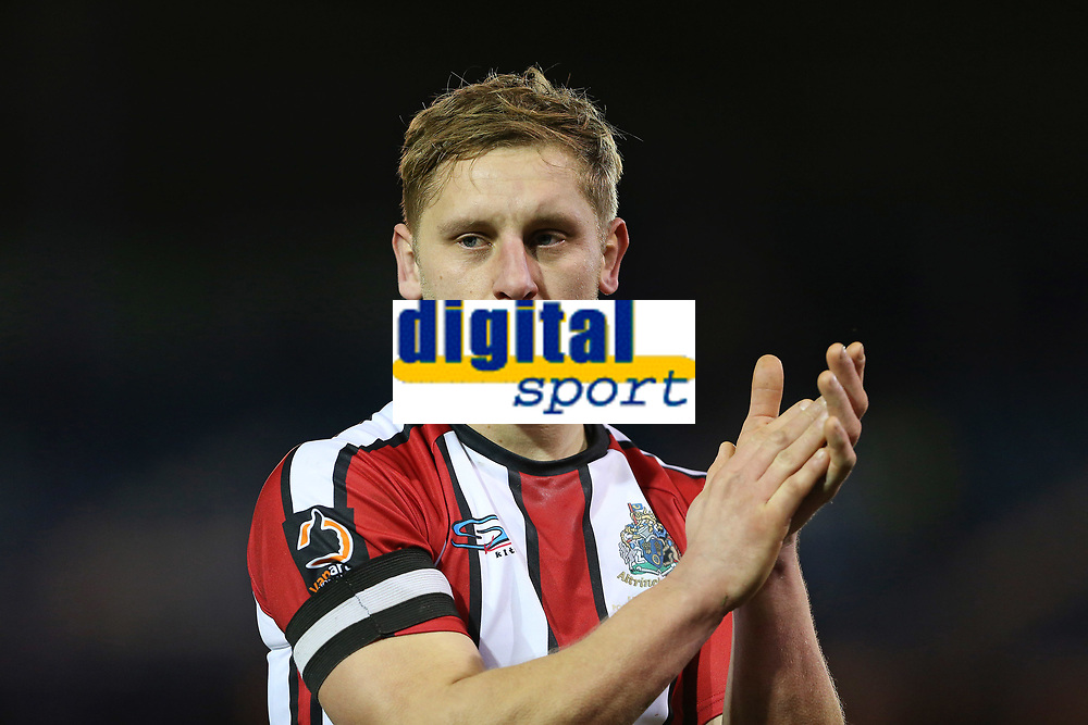 Football - 2019 / 2020 Emirates FA Cup - Second Round: Portsmouth vs. Altrincham<br /> <br /> A dejected Jake Moult of Altrincham applauds the traveling fans after the final whistle at Fratton Park <br /> <br /> COLORSPORT/SHAUN BOGGUST